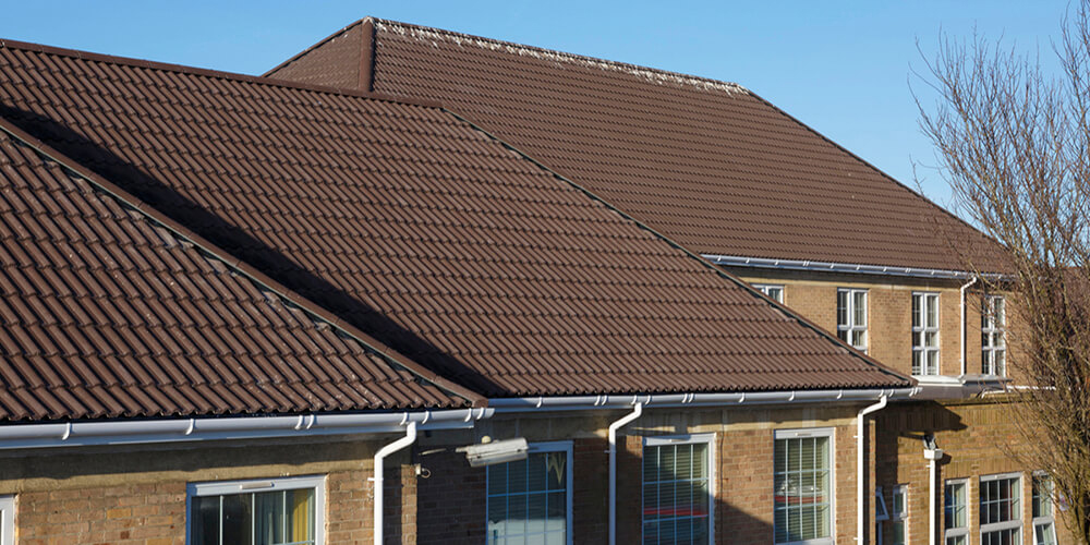 Bmi Ensures That Academy Roof Is Twice Underwritten Roofing Today