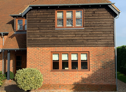 Galvinised steel gutters on smart traditional house