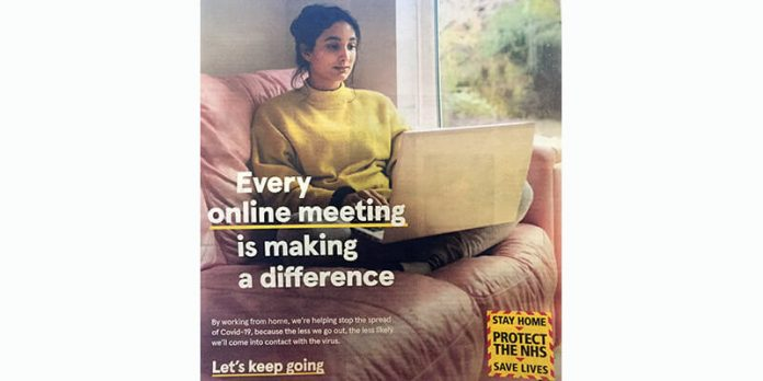 Government advert showing woman working on sofa