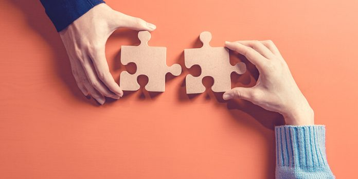NBS NFRC Partnership graphic with two hangs slotting together a jigsaw