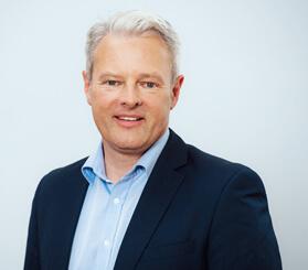 Headshot of Robert Schuster, director of DACH+HOLZ