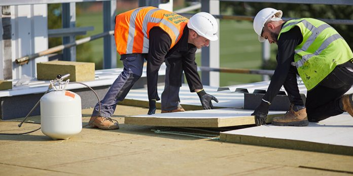 ROCKWOOL HARDROCK being installed on a flat roof