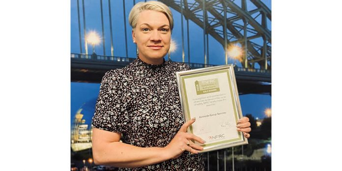woman with certificate avonside group health and safety