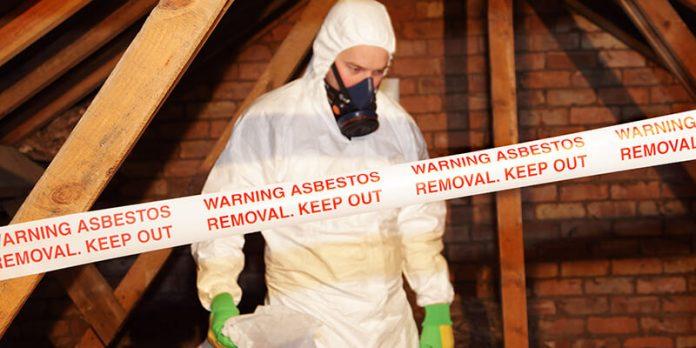 Image of worker in asbestos safety gear - asbestos